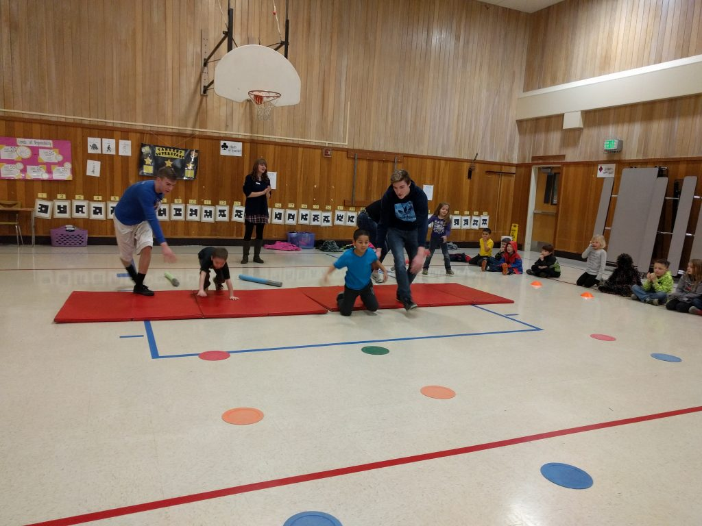 Kids rolling around in a gym