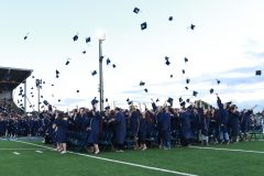 Grads throwing their hats.